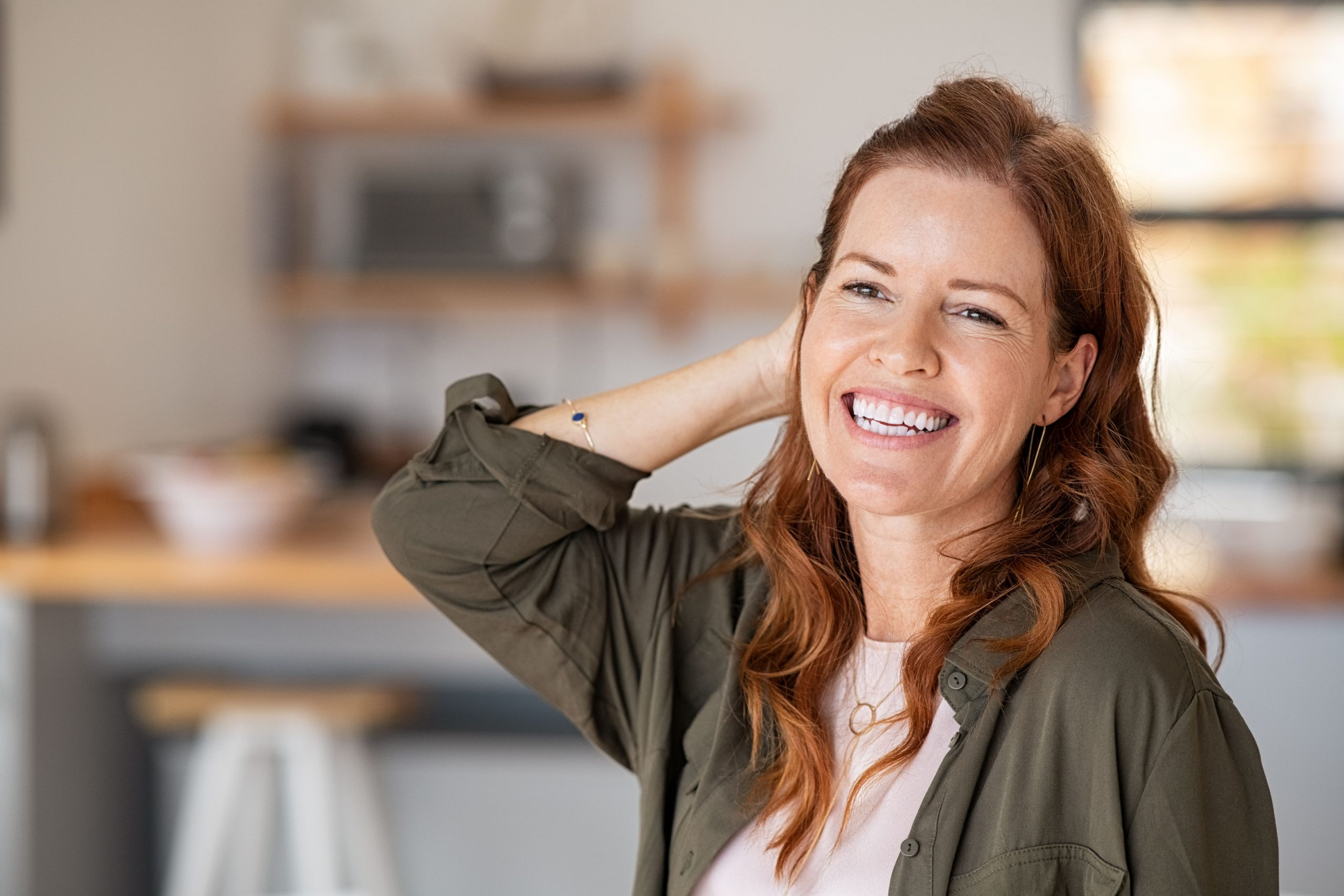 happy woman experiencing early menopause