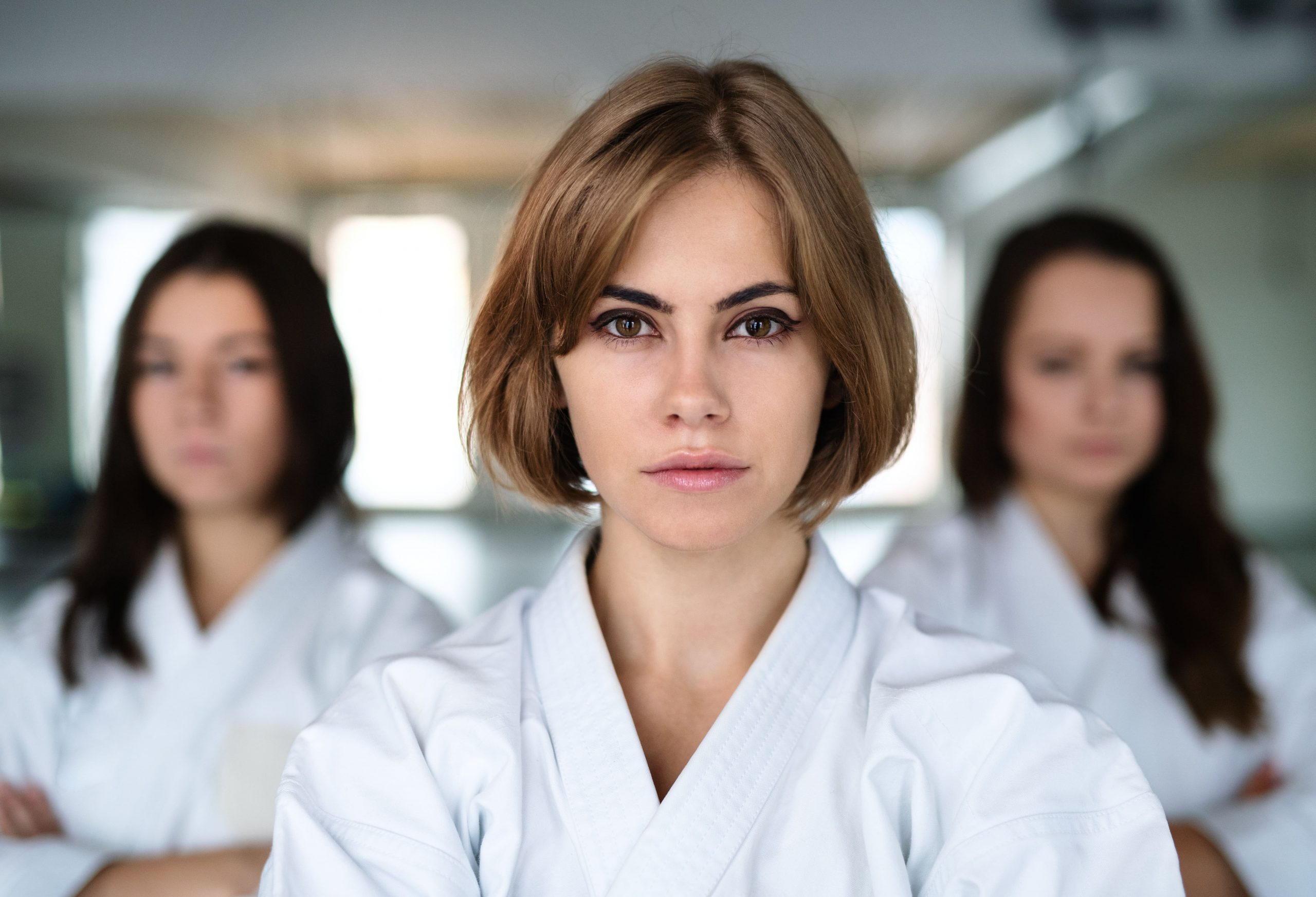 Group of potential egg donors practicing karate in free time
