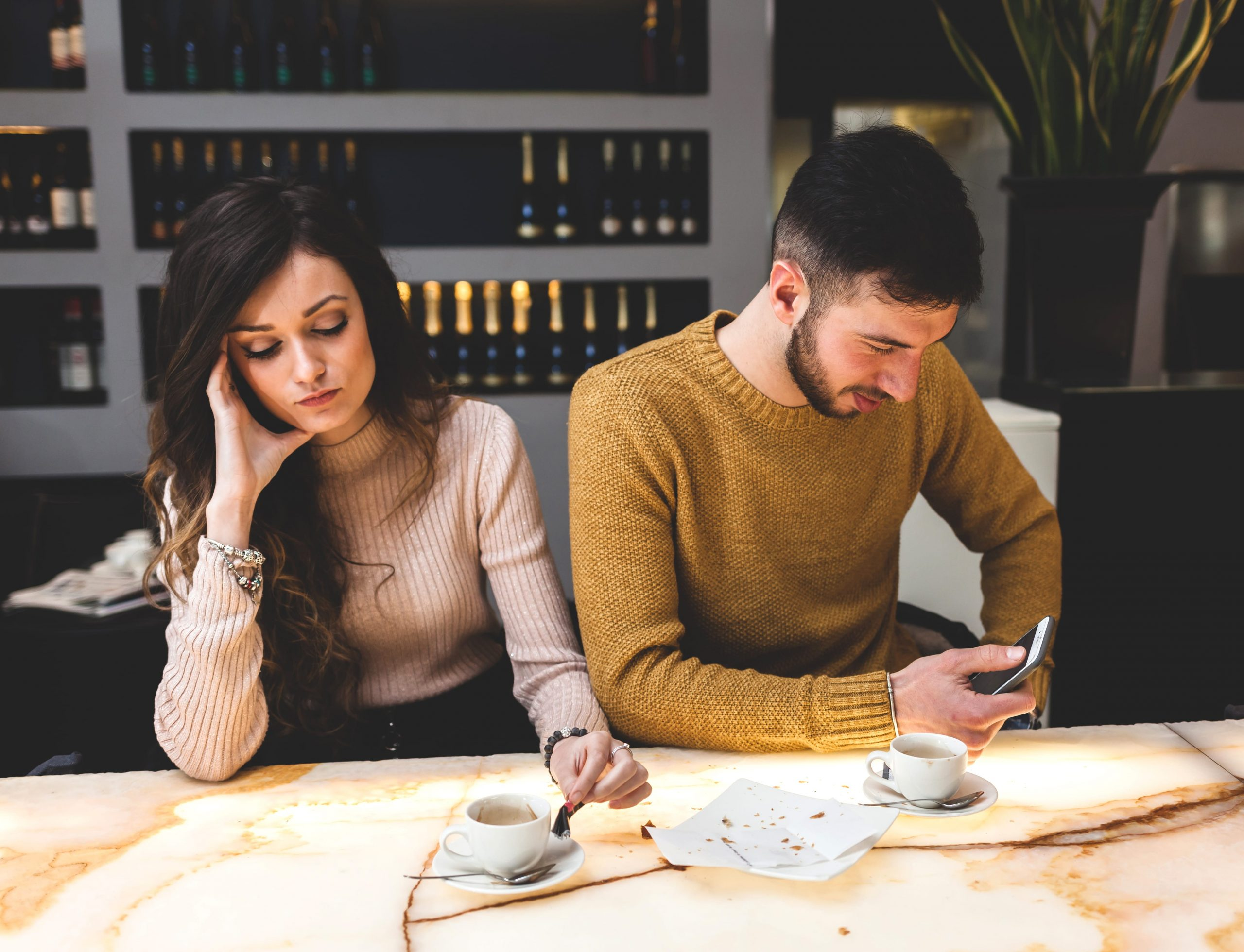 Young couple at coffee bar worried about unexplained infertility